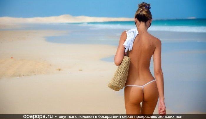 Фотография: загоревшей девушки Яниты с крепкой попкой на пляже в купальнике